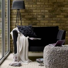 cosy living room with black sofa