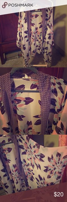 Plus size flower kimono top Wow! The pattern is so stylish and the beautiful plum, blue and pink colors complement each other so well. Great for smarting up those jeans or to cover up arms you aren't happy with. NWOT Charming Charlie Other