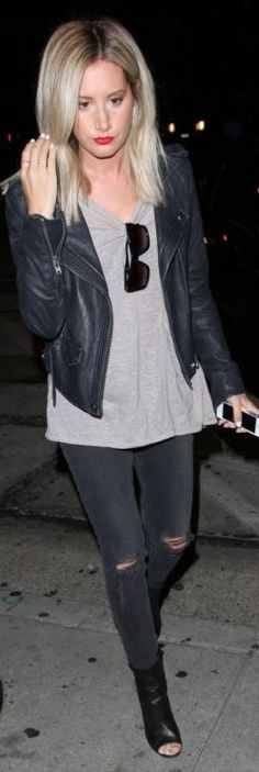 Who made  Ashley Tisdale's gray ripped skinny jeans and black leather jacket