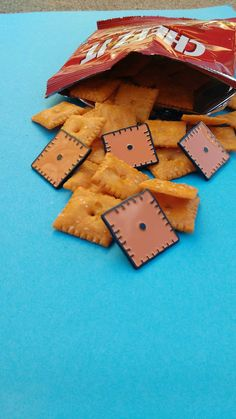 Represent your love of cheesy snacks with this 1 cheesy cracker enamel pin.
