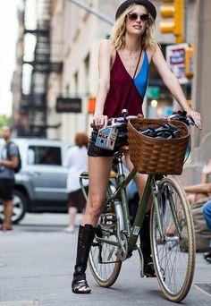 TAYLOR BAGLEY rides a bike in New York