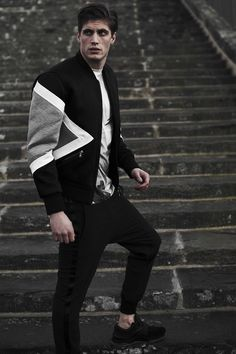 Gray, Black, and White Letterman Style Jacket Paired With Black Pants and Shoes