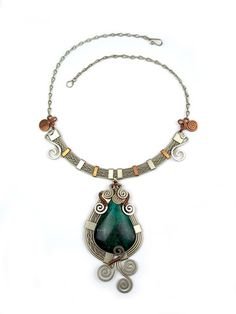 Wire Wrap Necklace: Bird of Paradise.  Copper and german silver hammered twice-wrapped natural Peruvian Turquoise (Chrysocolla) stone.