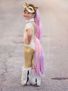a unicorn for halloween Not crazy about the unitard but loving the make, tail, and fringe leg warmers