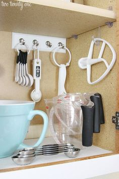 A few sets of hooks to make all of your baking tools easy to grab when it's time for a batch of cookies.: https://www.buzzfeed.com/nataliebrown/useful-things-that-will-actually-organize-your-kitchen?crlt.pid=camp.xLlWA0Wf90MB