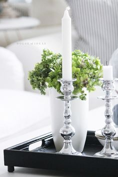 black tray, silver and white candles