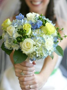 Hand-Tied Bouquet Featuring Hydrangeas, White and Yellow Roses and Blue Delphinium