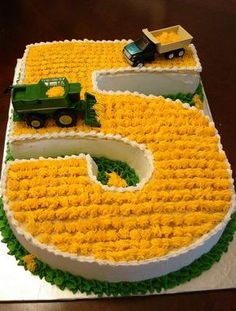 Birthday cake for five-year-old in the shape of the number 5 with farming trucks.JPG