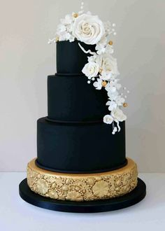 Black and Gold Tiered Cake with White and Gold Florals
