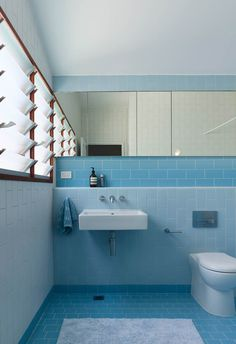 **Bathroom** Contrasting with the rest of the house, the bathroom adopts a playful blue palette with contrasting shades of blue tiles adding depth. Blue Bathroom Vanity, Brown Bathroom, Small Bathroom, Blue Bathrooms, Bathroom Faucets, Bathroom Wall, Shiplap Bathroom, Modern Bathrooms, Beautiful Bathrooms