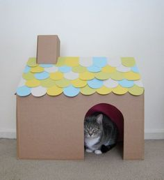 DIY Cat House. Something to use all of the moving boxes for. #woodencathouse