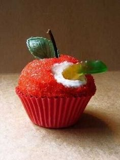 Love it! Gummy worm coming out of apple cupcake.