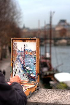Paris Artist--I believe I bought two small painting from this guy. He painted himself sitting on the side, fishing, with all the beautiful scenery around him. Lol!
