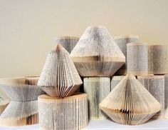 Book Statement: these wonderful works of art are folded book pages made in Munich, Germany.