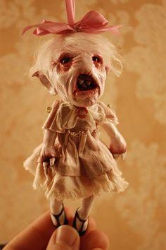 creepy little doll:
