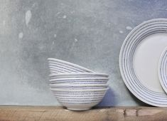 Our collection of Bria ceramic bowls are beautifully handmade in Vietnam. The stylish dot pattern is painted free hand in a deep indigo glaze. The subtle elegance of this collection makes it a perfect addition to a table. Natural Contour, Cereal Bowls, Organic Shapes, Serving Platters, Plate Sets, Ceramic Bowls, Paint Designs, A Table, Dinnerware