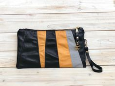 Another clutch in black grey and mustard . . The front panel is made with reclaimed leather from items of clothing. It. Is. Soft!  . . The reverse is plain black in a premium more sturdy leather to help keep its shape. . . Inside is lined with grey wrap scrap and has a zipped pocket. The wrist strap is detachable.  . . And its up on my shop #linkinbio  . . #sewteadough #daggerandthorn #leather #leatherclutch #leatherbag #wrapscrap #babywearing #reclaimed #reclaimedleather #reuse… Plain Black, Black And Grey, Babywearing, Leather Clutch, Reuse, Mustard, Scrap, Pocket, Sewing