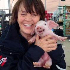 Here's a picture of my mom holding a smiling piglet. - Imgur