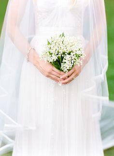 bride holding baby's breath bridal bouquet http://itgirlweddings.com/dreamy-weddings-do-come-true/
