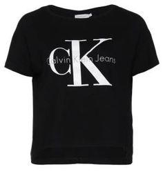Calvin Klein Jeans Camiseta Print Meteorite Camisetas Y Tops De Mujer La mezcla del lujo y el estilo más urbanita está en la calle, y cualquiera puede lucir su encanto más cool mezclando camisetas y tops de mujer con faldas de lujo.