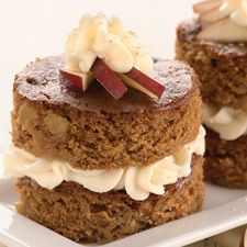 A biscuit cutter helps transform this moist, spicy sheet cake into elegant individual layer cakes.