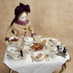 """They're late for tea again."" French Bisque Poupee by Gaultier in Lovely Antique Costume; circa 1875."