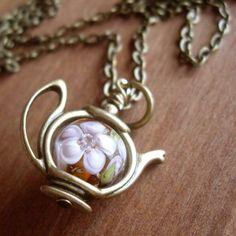 lampwork bead in teapot frame