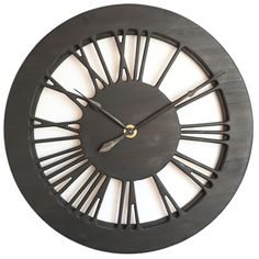 """This very impressive large black skeleton wall clock is carefully designed to provide a strong statement in your living room. It is not just a clock but a substantial piece of wall art that will provide an incredible """"wow"""" effect on your guests. It displays beautifully hand carved Roman numerals and you can see the wall through it."""