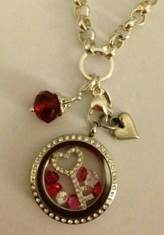 Large silver locket with crystals, heart key plate, assorted accent stones, and dangles.