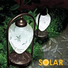 Solar Etched Dragonfly Lights. No wiring or batteries required for these beautiful lights that double as garden art! The intricate pattern makes shade pretty by day and is cast on the ground for dramatic effect at night.