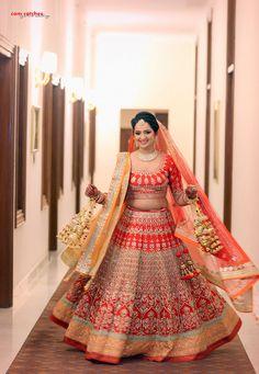 bride red and gold lehenga, twirling lehenga, twirling bride, gold kaleere, orange dupatta