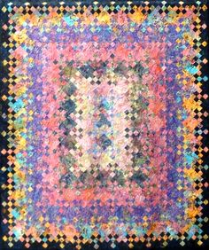 Cottage Garden quilt by Lee Ann Ferring, 2014 Lakeview Quilters Guild show.  Blooming nine patch quilt.  Photo by Sue Garman