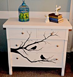 Antique chest of drawers painted with creamy white chalk paint..Birds and branches painted in silhouette