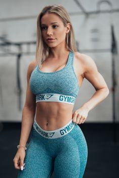 Blue workout style. Gymshark Athlete Robin Gallant pairs the Flex Sports Bra and Leggings in Deep Teal and Ice Blue.