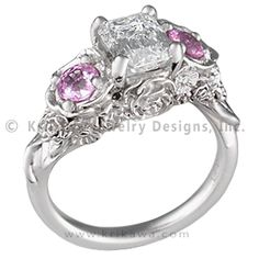 Floral Bouquet Three Stone Engagement Ring - The flowers in this intricate engagement ring design will never wilt! Your center stone sits atop the bouquet, and your side gemstones are set inside petals.   - This organic ring has an 1.08 ct K, VS2 Crisscut emerald cut diamond and pink sapphires in its petals.