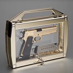 oh man that's a nice #gold handgun and carrying case | Essentials (men's accessories), visit http://www.pinterest.com/davidos193/