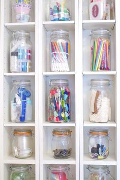 Craft supplies in jars on their own little shelves!