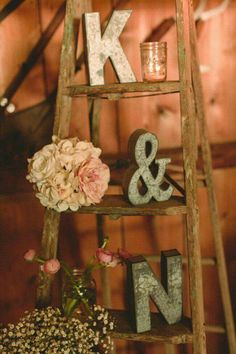 This is really cute. We need to find an old wood ladder. Hobby Lobby probably has the letters.