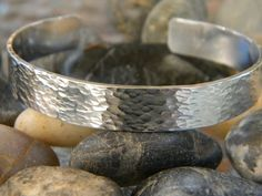 """Sterling Silver is timeless and beautiful. This cuff comes in a variety of sizes to suit your needs. Each one is hand hammered and polished to a beautiful shine. All bracelets are 6"""" long and will fit"""