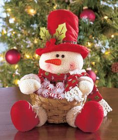 Plush Character Basket looks cute on tables, counters or buffets. He wears a holiday hat with holly and fabric accents and holds an attached bamboo basket that' Snowman Christmas Decorations, Christmas Snowman, White Christmas, Christmas Stockings, Christmas Ornaments, Holiday Hats, Holiday Decor, Holiday Baskets, Basket Decoration