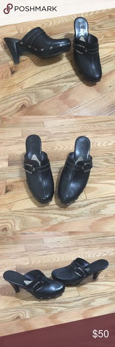 Cole Haan mules Black with silver accents. 31/2 in heel 1/2 in platform size 7AA HEELS SHOW SMALL AMOUNT OF WARE. Cole Haan Shoes Mules & Clogs