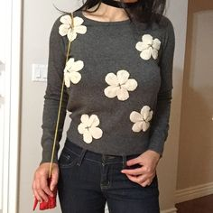 "Gray sweater with flowers Brand new, never worn . Chic floral appliqué sweater, light weight , soft  feel material , Key hole button in the back . True to size with stretch . Not itchy,  No Trades. Bundle 3 or more 15% Discount . Model is wearing size small.  5'3"" Also available in White. Flirty Meow Boutique  Sweaters Crew & Scoop Necks"