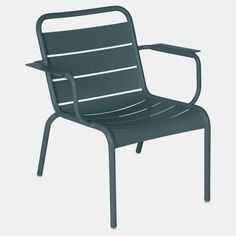 """New this year, the slightly smaller Luxembourg Lounge Armchair is perfect for both comfort and ease! It sits at a nice incline for sunning and chatting and features armrests alongside an aluminum frame, which makes it lightweight and easy to move around. It's sophisticated and timeless and will certainly bring joy! Measurements: 29""""h x 23""""w x 29""""d x 24""""h armsMaterials: Powder-coated aluminumListed as a single chair but must be purchased in sets of 2They do not fold but they are stackable Availab Outdoor Fun, Outdoor Chairs, Outdoor Furniture, Outdoor Decor, Garden Furniture, Lounge Chairs, Luxembourg, Design Online Shop, Gris Taupe"""