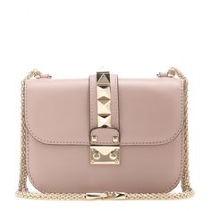 Valentino - Lock Small leather shoulder bag - Valentino's 'Lock' bag is a cult classic. We love the compact shape and signature chain shoulder strap, plus the dusty pink hue and gold-tone studs that offer timeless allure. Carry it next to a printed shirt and denim shorts as an elegant final note. seen @ www.mytheresa.com