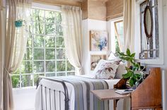 Instead of sleeping bags, try a full-size bed. The Southards designed the tree house around this iron bed, which was originally in a guest room in the main house. Made of bark cloth, the pillow's material is aptly named for its environment.