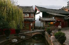 Old Town Lijiang, China +   Also has a very good cultural show:  Impression Lijiang which is shown at the foot of Jade Dragon Snow Mountain. Yak rides also available at base of mountains. Stop at Yangtse River (surrounded by rice terraces) on the way to Tiger Leaping Gorge.