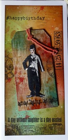 Background inked with distress inks and then stamped with some of the Tim Holtz stamps. Charlie Chaplin deep red stamp