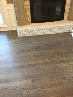 Red oak floors. Two parts Classic Gray and one part Jacobean. Three coats Bona Traffic HD. See other photo below.