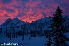 A firery  skies at sunrise over Mt. Shuskan. As viewed from the Heather Meadows day lodge. Mt. Baker Ski Area, North Cascades Washington  Order prints at: prints.grantgunderson.com