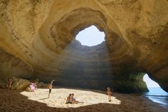 """Located near the southern tip of Portugal, there is a small beach town that holds a big secret. While everyone else is on the beaches of the Algarve, head for The town of Benagil, a small fishing town which has a great beach—but even more importantly—has a beach sea cave. This large rock formation is only accessible by the sea, with naturally formed arches leading into a large cavern. """